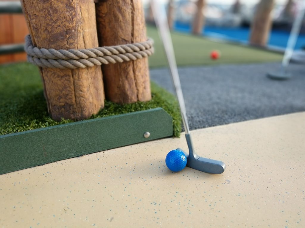 crazy golf, golf putter and golf ball, blog post listing crazy golf courses in Gloucestershire