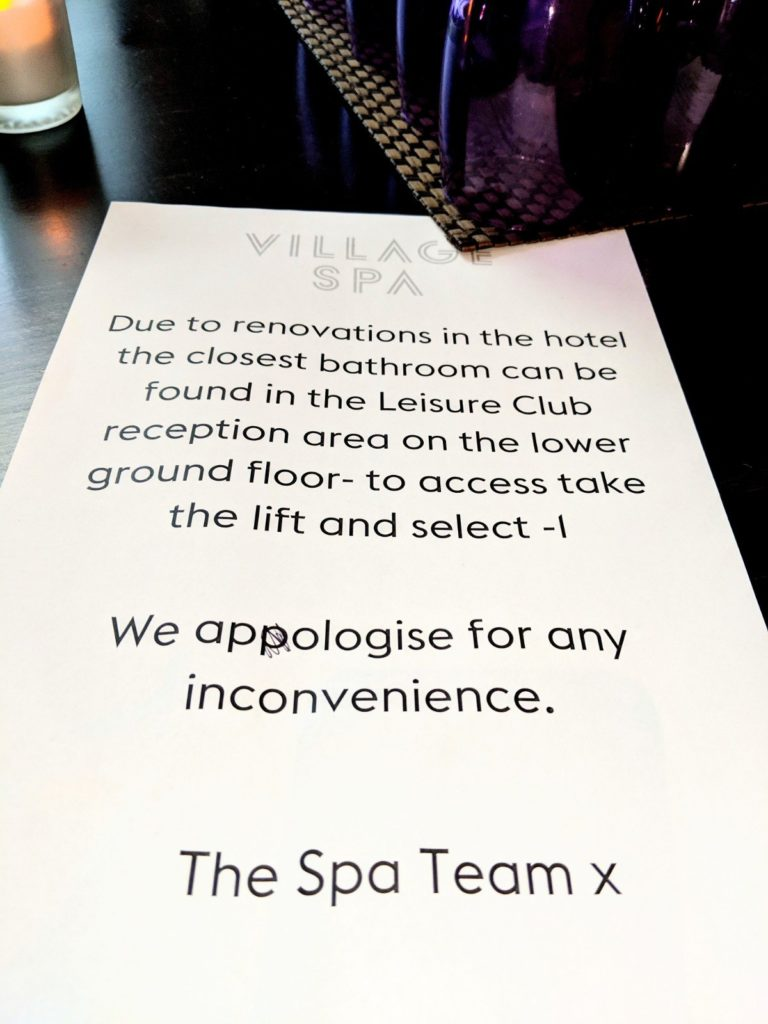 Sign at the Village Spa in Swindon explaining that you must go down to the lower ground floor should you need to use the toilets.