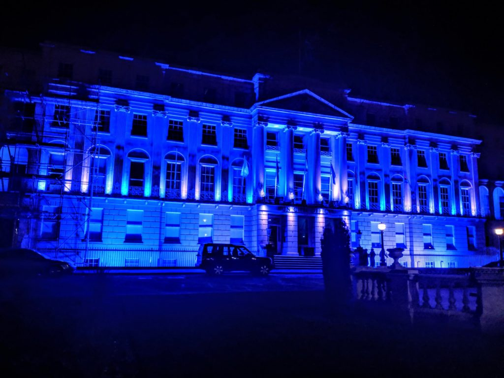 The grand regency building of Cheltenham's municipal offices, lit up blue for Light Up Cheltenham