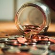Photo of coins spilling out of a jar, by Josh Appel on Unsplash