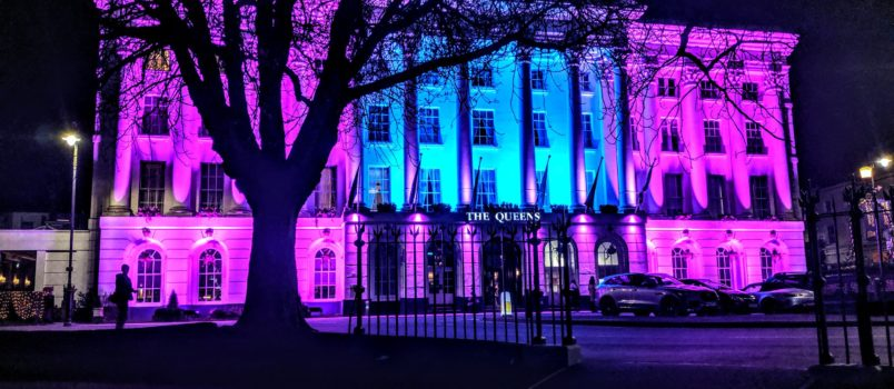 The Queens Hotel in Cheltenham lit up with blue and purple lights